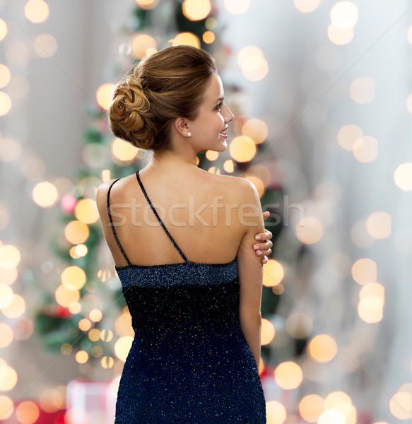 Sorrindo vestido de noite pessoas férias glamour árvore de natal Foto stock © dolgachov
