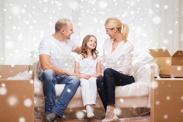 Sonriendo padres nina nuevo hogar familia personas Foto stock © dolgachov