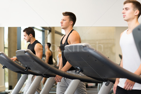 group of men exercising on treadmill in gym Stock photo © dolgachov