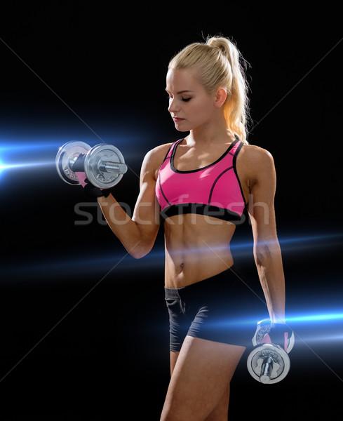 Kobieta ciężki stali hantle fitness Zdjęcia stock © dolgachov