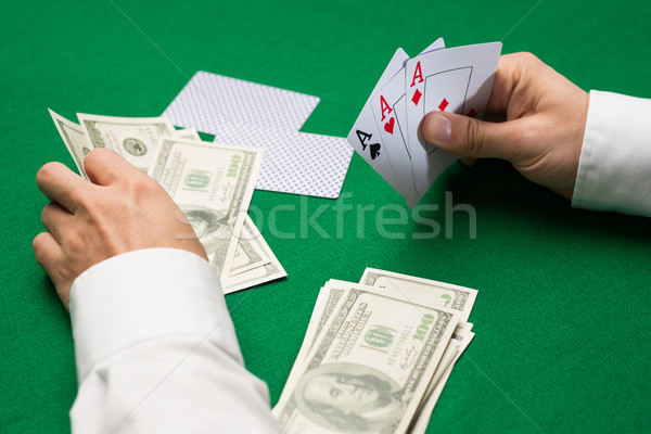 poker player with cards and money at casino Stock photo © dolgachov