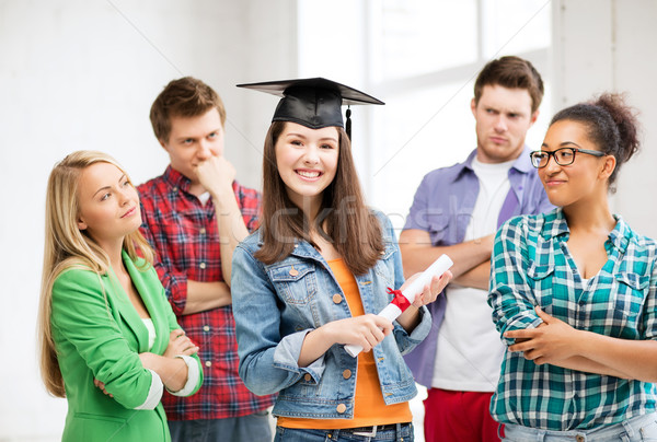 girl in graduation cap with certificate Stock photo © dolgachov
