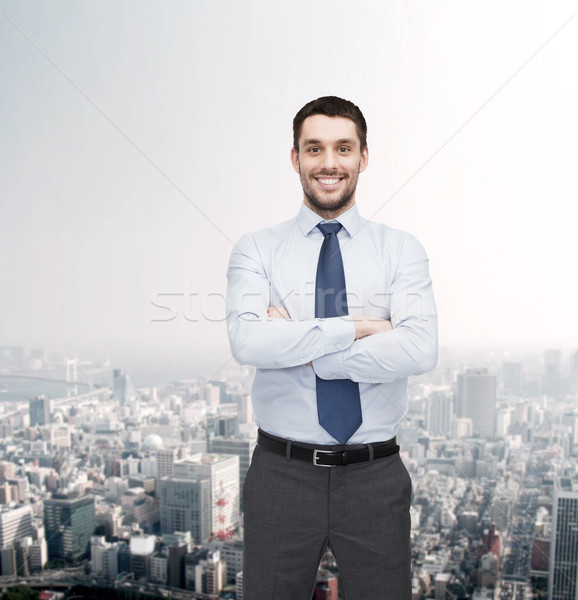 Stock photo: handsome businessman with crossed arms