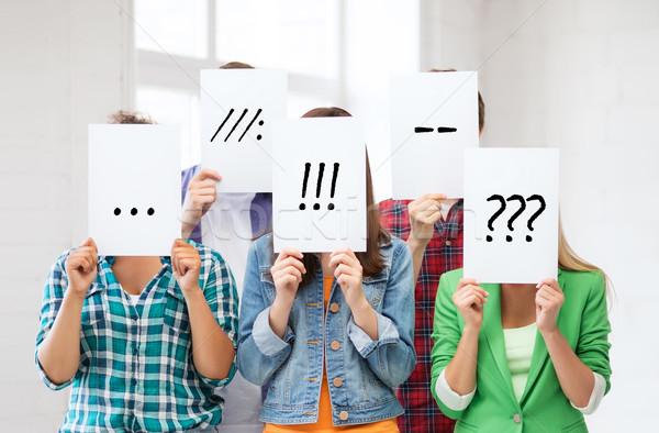 Arkadaşlar Öğrenciler yüzler kağıtları insanlar duygular Stok fotoğraf © dolgachov