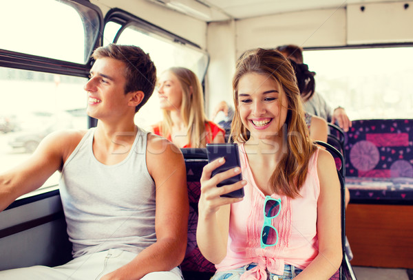 smiling couple with smartphone making selfie Stock photo © dolgachov