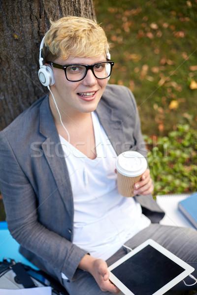Boldog tizenéves fiú fejhallgató táblagép zene technológia Stock fotó © dolgachov
