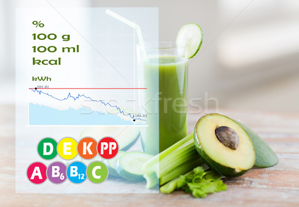 close up of fresh green juice glass and vegetables Stock photo © dolgachov