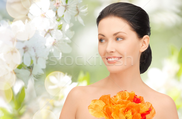 Stock photo: beautiful young woman with flowers