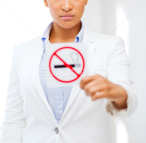 african woman with restriction no smoking sign Stock photo © dolgachov