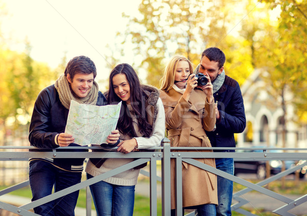 Stock photo: group of friends with map and camera outdoors