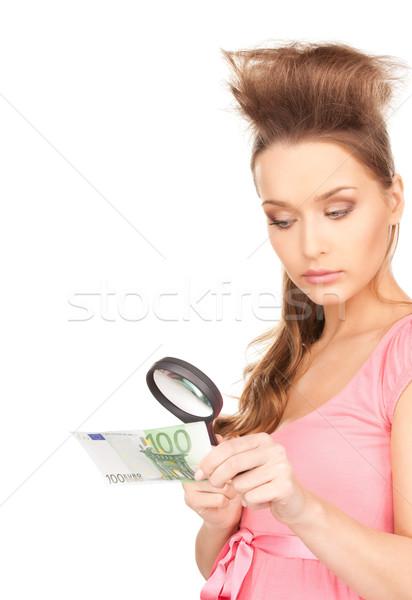 Vrouw vergrootglas geld gezicht euro vrouwelijke Stockfoto © dolgachov