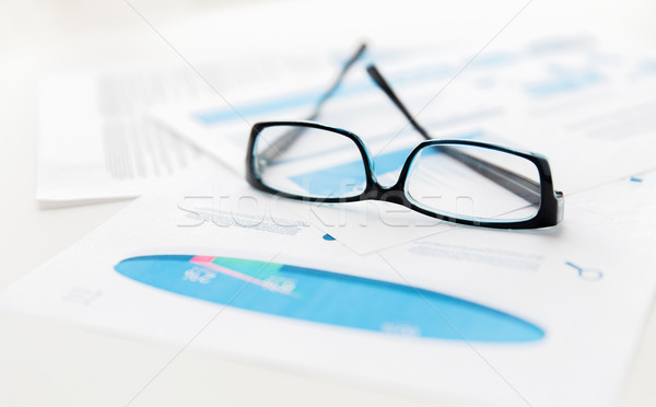 close up of eyeglasses and files on office table Stock photo © dolgachov