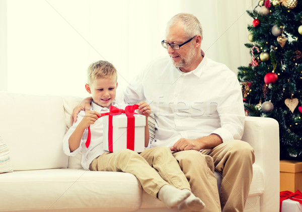 smiling grandfather and grandson with gift box Stock photo © dolgachov
