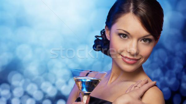 Uśmiechnięta kobieta koktajl niebieski światła strony Zdjęcia stock © dolgachov