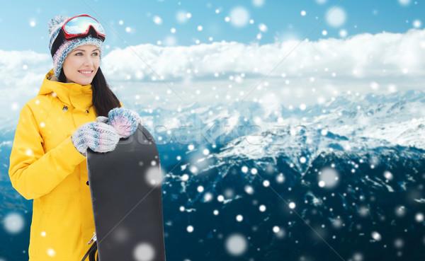 Boldog fiatal nő hódeszka hegyek tél szabadidő Stock fotó © dolgachov