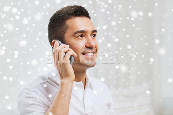 Feliz hombre llamando casa tecnología Foto stock © dolgachov