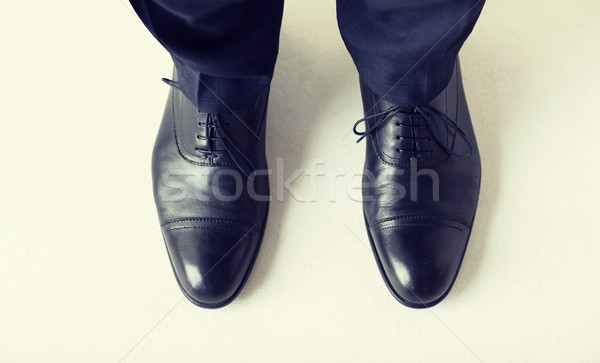 close up of man legs in elegant shoes with laces Stock photo © dolgachov