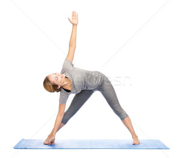 Mujer yoga triángulo plantean fitness Foto stock © dolgachov