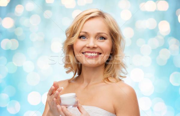 happy middle aged woman with cream jar Stock photo © dolgachov