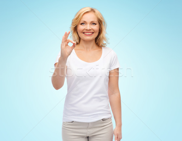 Heureux femme blanche tshirt Photo stock © dolgachov