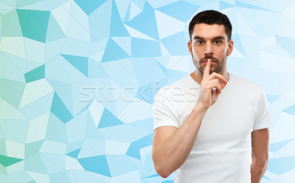 man making hush sign over low poly background Stock photo © dolgachov
