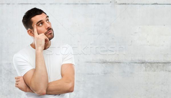 Hombre pensando gris dudar personas muro de piedra Foto stock © dolgachov
