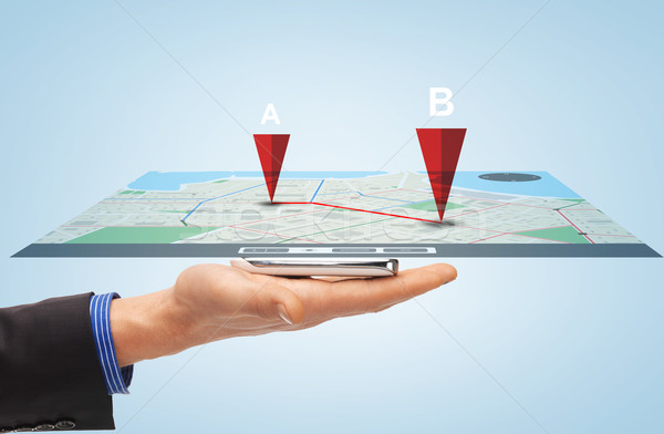 male hand with smartphone gps navigator map Stock photo © dolgachov