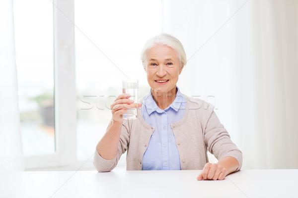 Boldog idős nő üveg víz otthon Stock fotó © dolgachov