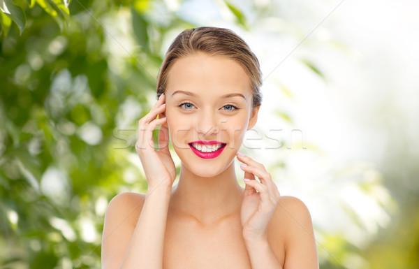 笑みを浮かべて 若い女性 ピンク 口紅 唇 美 ストックフォト © dolgachov