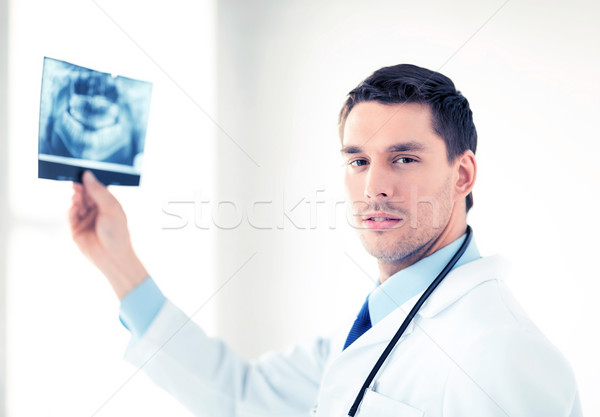 male doctor or dentist with x-ray Stock photo © dolgachov