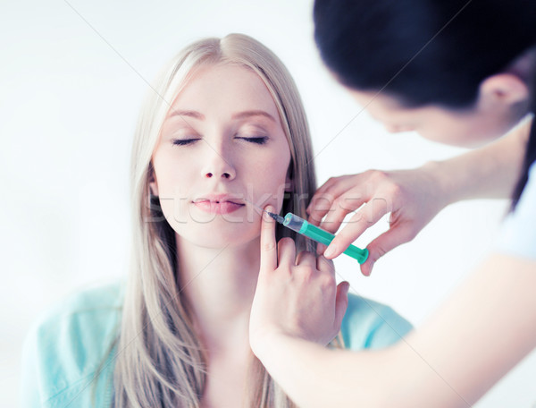beautician with patient doing injection Stock photo © dolgachov