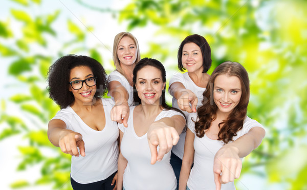 group of happy women pointing finger on you Stock photo © dolgachov