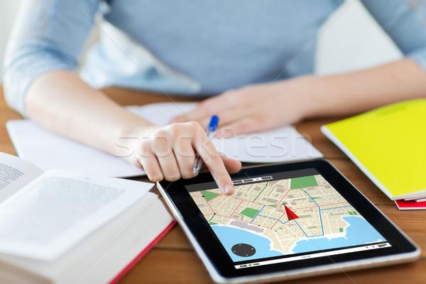 close up of woman with navigator map on tablet pc Stock photo © dolgachov