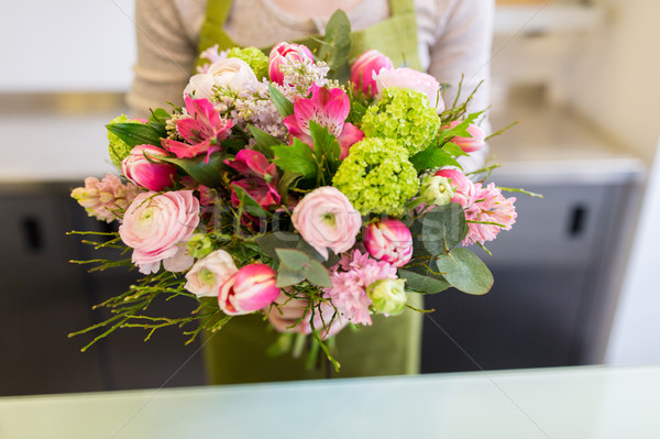 close up of woman holding bunch at flower shop Stock photo © dolgachov