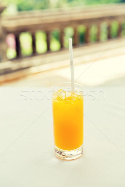 glass of fresh orange fruit juice at restaurant Stock photo © dolgachov