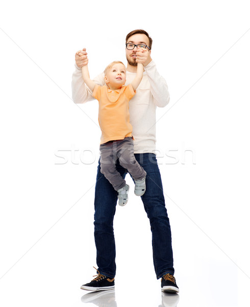 father with son playing and having fun Stock photo © dolgachov