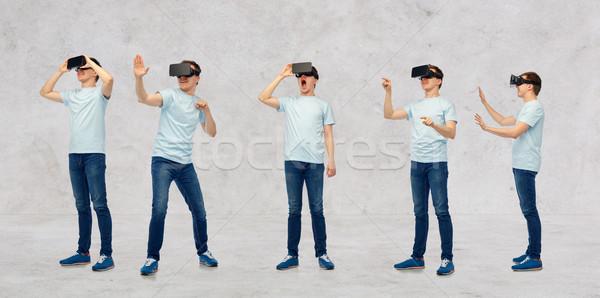 Adam sanal gerçeklik kulaklık 3d gözlük ayarlamak Stok fotoğraf © dolgachov