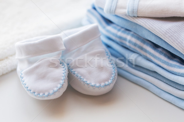 close up of baby bootees and clothes for newborn Stock photo © dolgachov