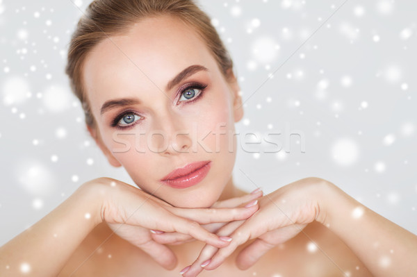 close up of beautiful woman face and hands Stock photo © dolgachov