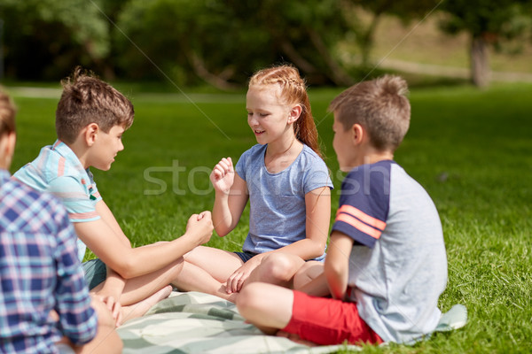 happy kids playing rock-paper-scissors game Stock photo © dolgachov