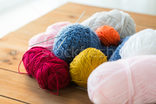 knitting needles and balls of yarn on wood Stock photo © dolgachov