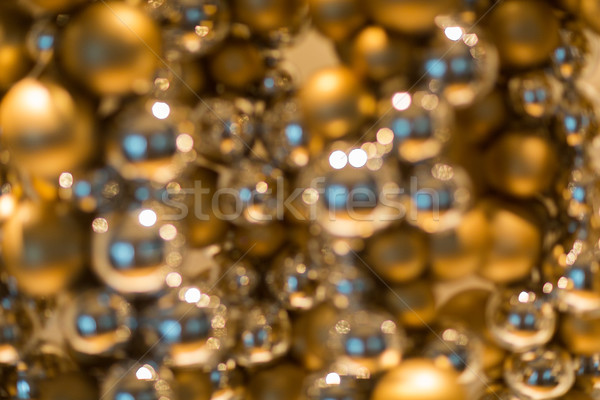 golden christmas decoration or garland of beads Stock photo © dolgachov