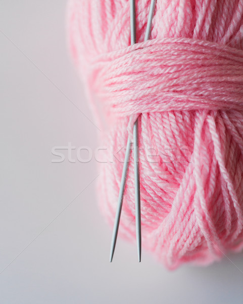 close up of knitting needles and pink yarn ball  Stock photo © dolgachov