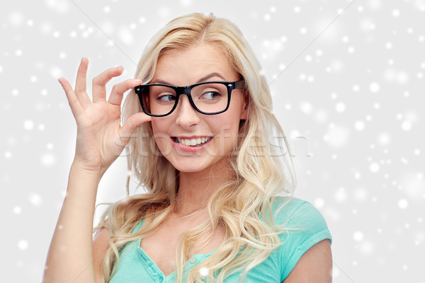 happy young woman or teenage girl in glasses Stock photo © dolgachov