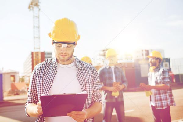 Groep bouwers buitenshuis business gebouw teamwerk Stockfoto © dolgachov