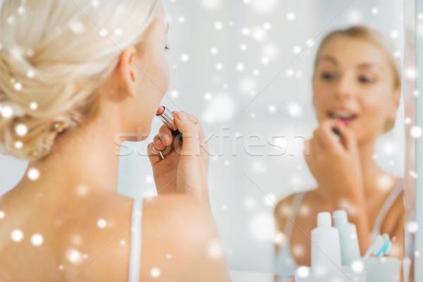 Donna rossetto compongono bagno bellezza Foto d'archivio © dolgachov
