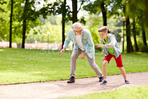 grandfather and grandson racing at summer park Stock photo © dolgachov