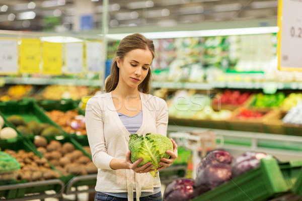 Mutlu kadın satın alma bakkal alışveriş gıda Stok fotoğraf © dolgachov