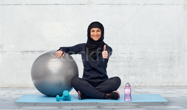 muslim woman in hijab with fitness ball and bottle Stock photo © dolgachov