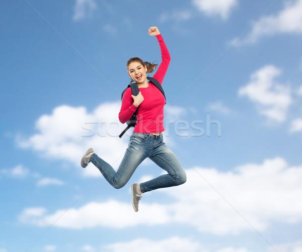 Gelukkig vrouw student rugzak springen onderwijs Stockfoto © dolgachov